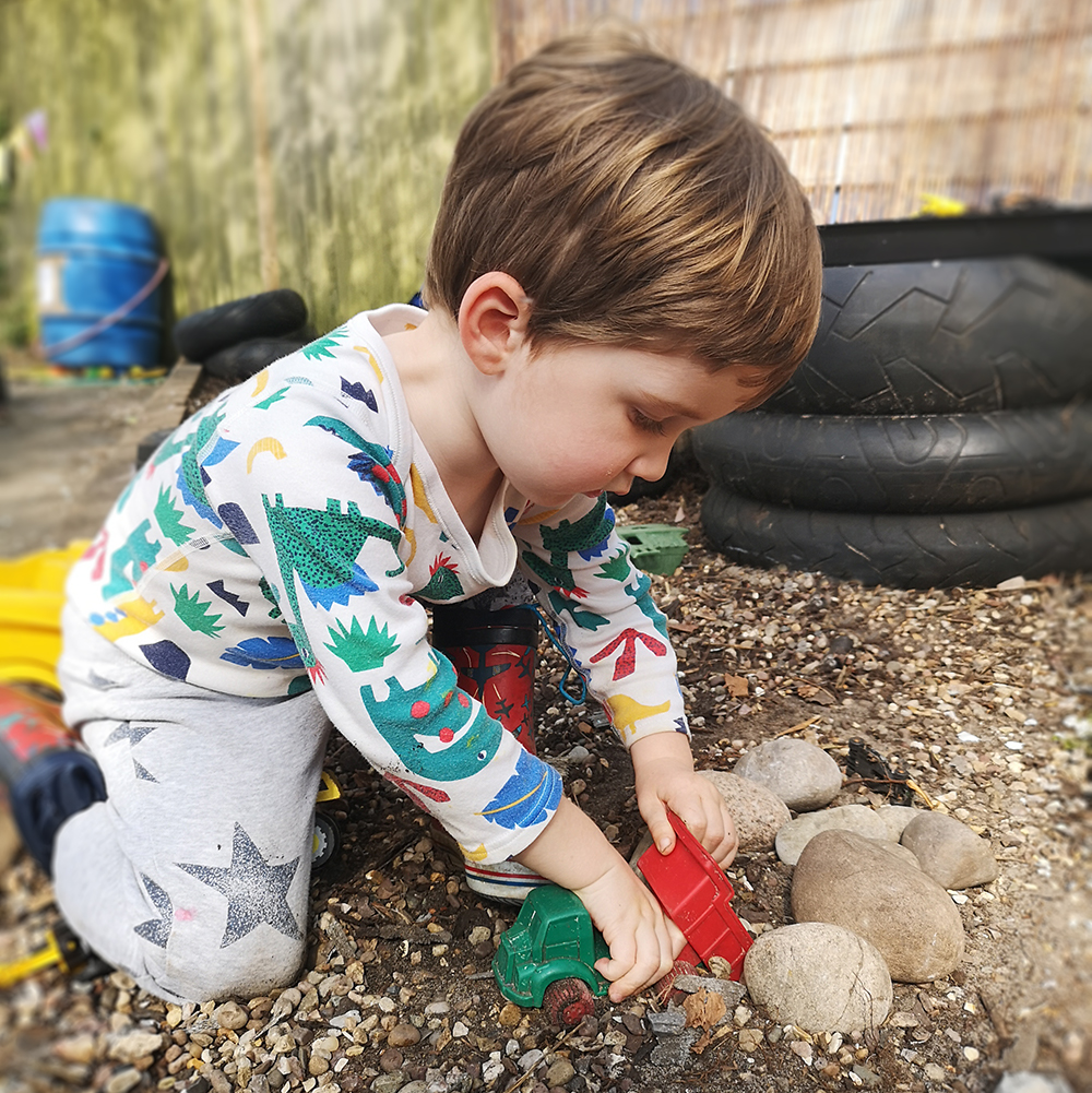 boy Playing In Gravel